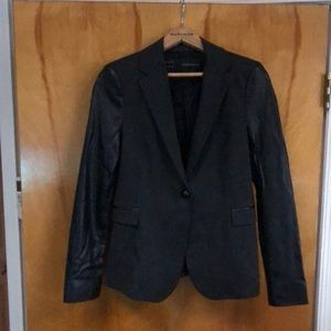 Women's jacket with leather sleeves